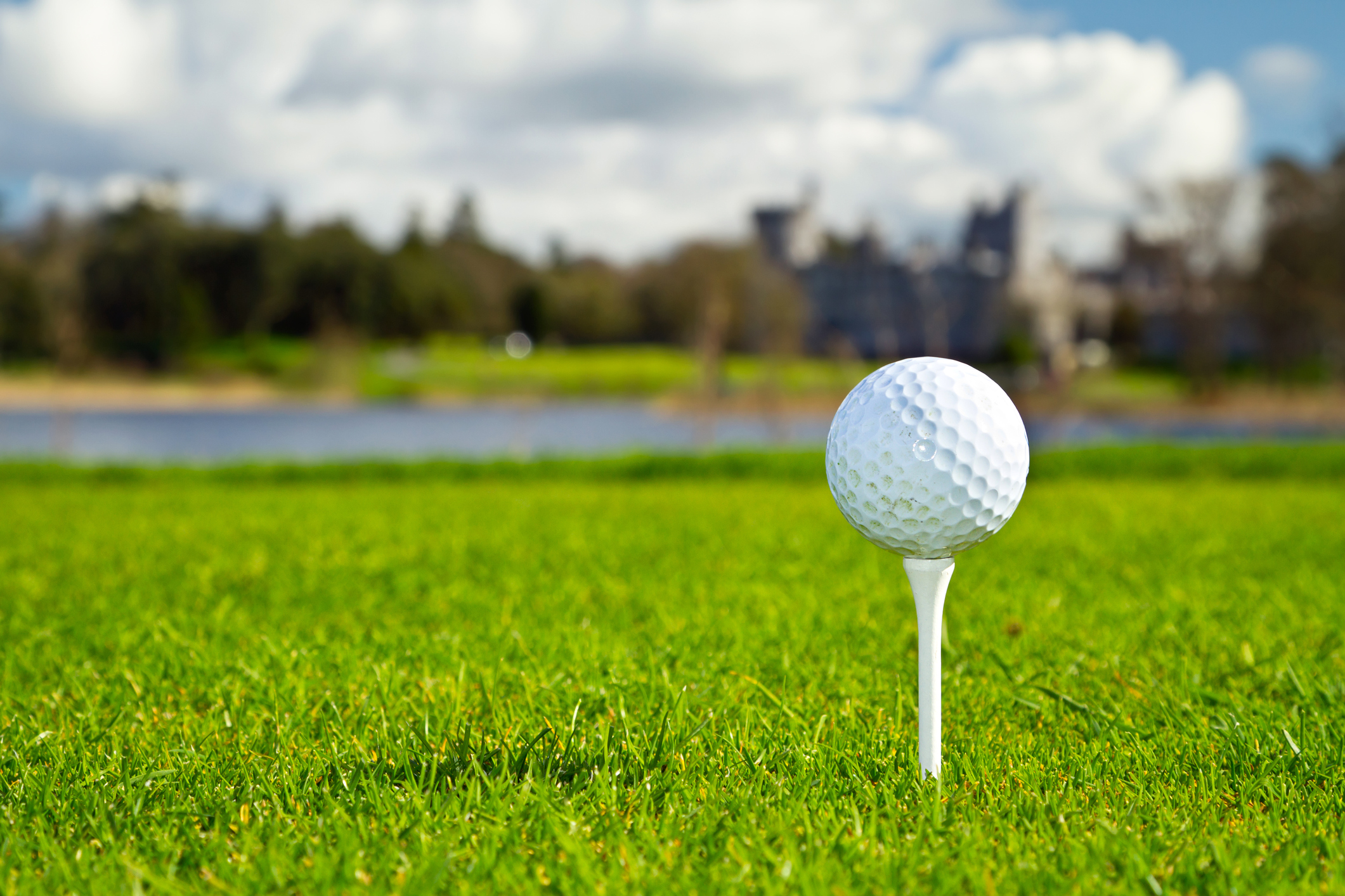 Golf ball on tee over golf course backgroundOther galleries: